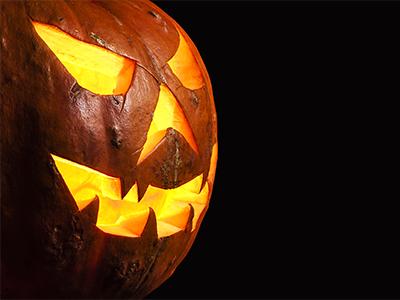 Three quarter view spooky halloween pumpkin Jack O Lantern shiny inside isolated