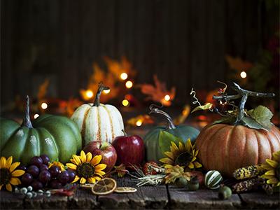 Autumn Thanksgiving pumpkin and leaf arrangement on old wood background